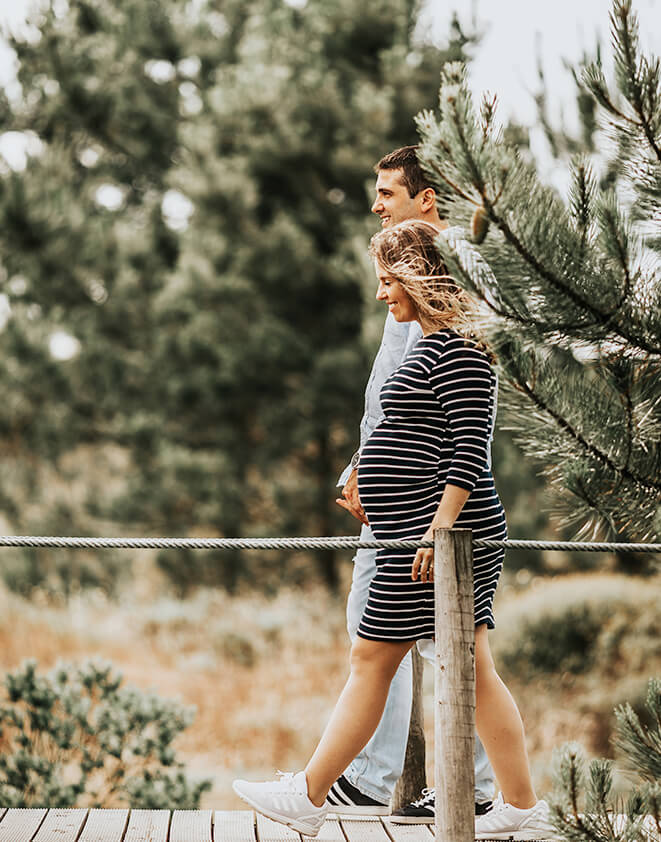 Pregnant mother walking with partner